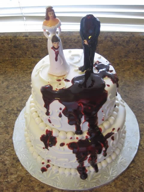Bride holding husband's head 2 tier divorce cake | riotdaily.com