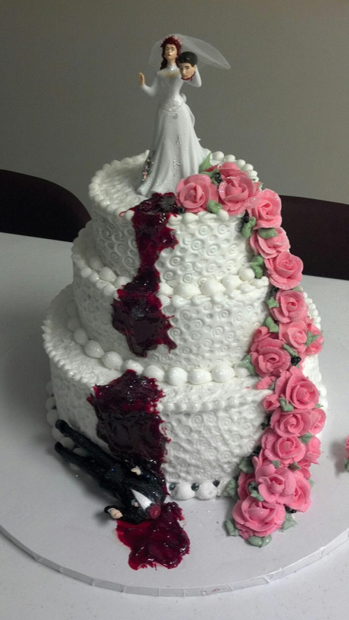 Bride holds grooms head with cascading pink roses tiered divorce cake | riotdaily.com