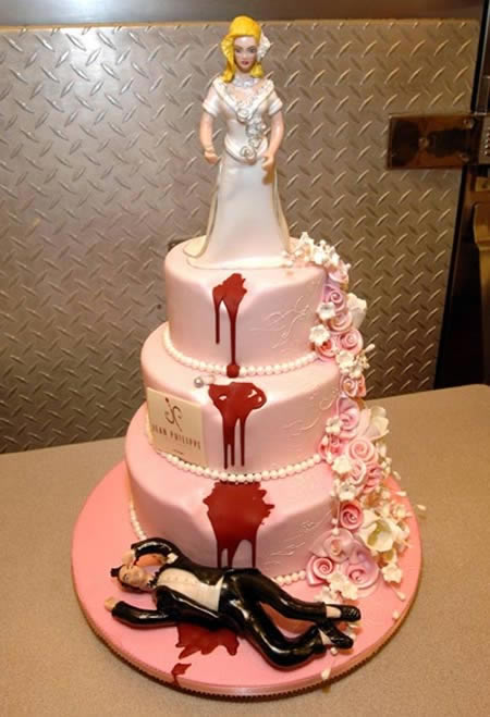 Pink Fondant Divorce Cake Bride Pushes Groom Off Cake riotdaily.com