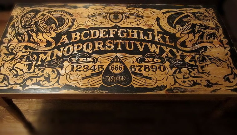 """don't play it alone!"""" 16 ouija board inspired tables 